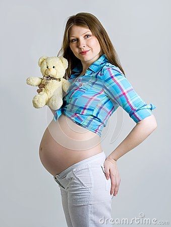 Pregnant woman caressing her belly