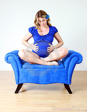 Pregnant woman on chair