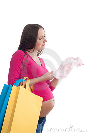 Pregnant woman choosing baby clothes