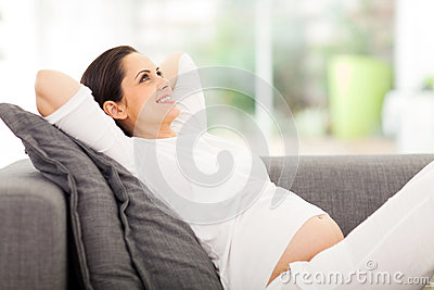 Pregnant woman daydreaming