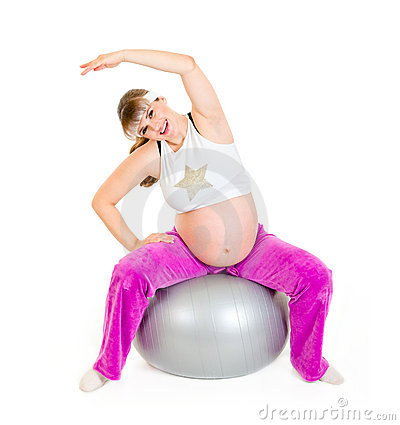 Pregnant woman doing exercises on  fitness ball