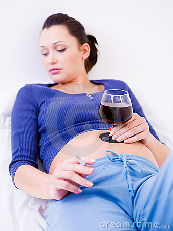 Pregnant woman drinking alcohol