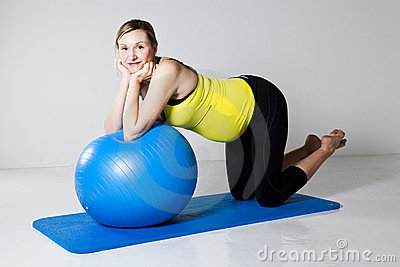 Pregnant woman exercising with fitness ball