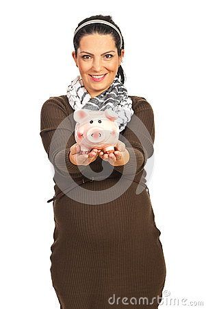 Pregnant woman giving piggy bank