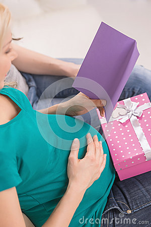 Pregnant woman with greeting card.