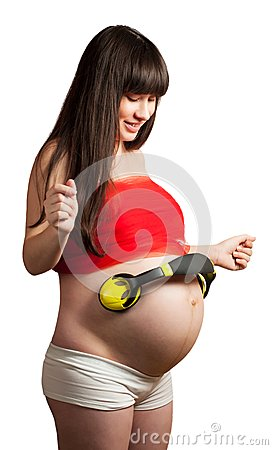 Pregnant woman with headphones. isolated