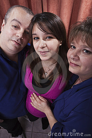 Pregnant woman with her parents