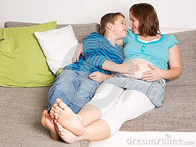 Pregnant woman with her son
