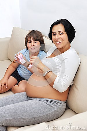 Pregnant woman and her young son