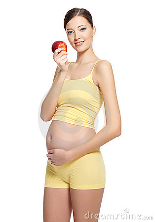 Pregnant  woman  holding red apple