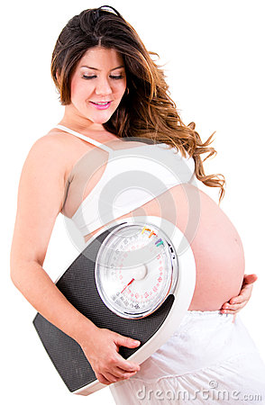 Pregnant woman holding a scale