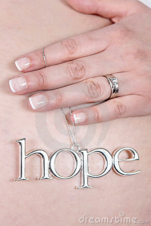 Pregnant woman with hope charm
