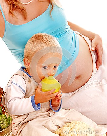 Pregnant woman and kid .