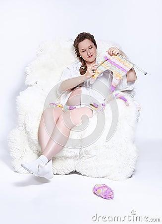 Pregnant woman knitting
