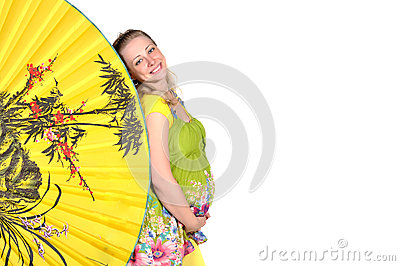 Pregnant woman looks out a yellow fan