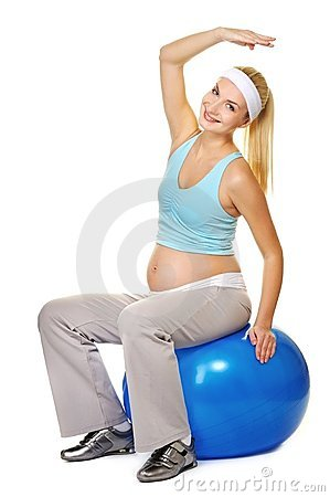 Pregnant woman making exercise