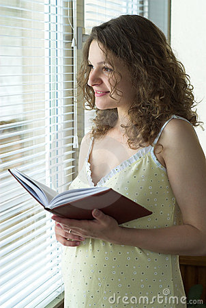 Pregnant woman near window