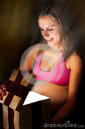 Pregnant Woman Opens Gift Box Christmas Present