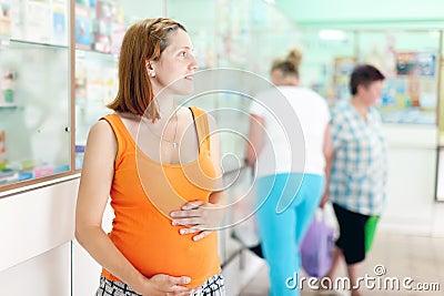 Pregnant woman at  pharmacy
