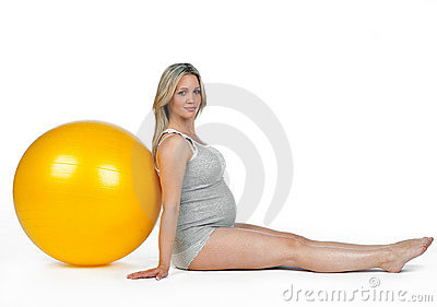 Pregnant woman with pilates ball