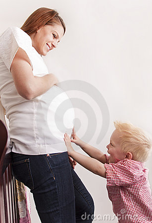 Pregnant Woman playing with her young son