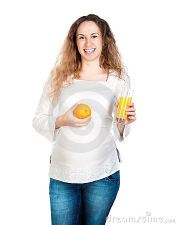 Pregnant woman with pretty stomach holding orange