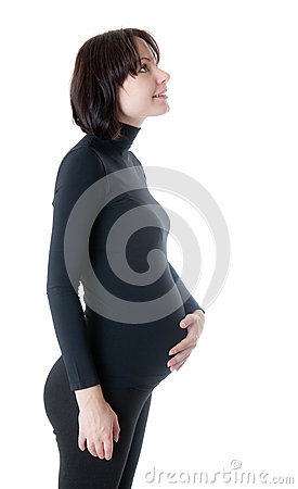 The pregnant woman in a profile