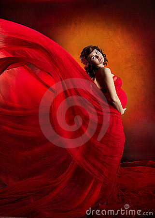 Pregnant woman in red flying waving dress.