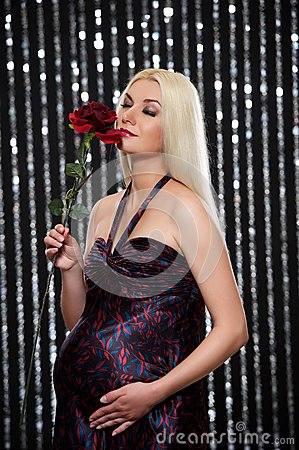 Pregnant woman with red rose