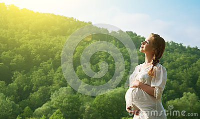 Pregnant woman relaxing and enjoying life