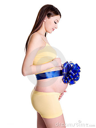Pregnant woman with ribbon on belly
