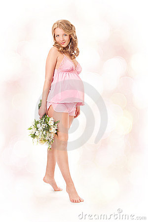 Pregnant woman smiling, looking at camera Stock Photo