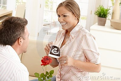 Pregnant woman smiling at man