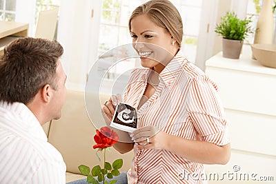 Pregnant woman smiling at man