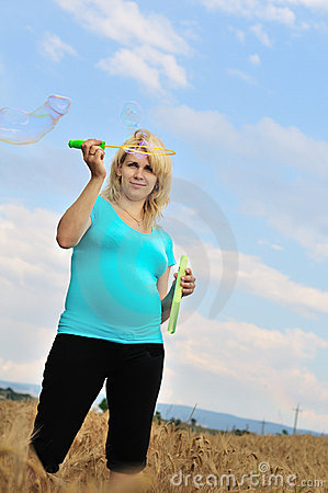 Pregnant woman with soap bubbles