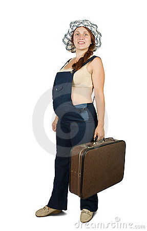 Pregnant woman  standing with suitcase
