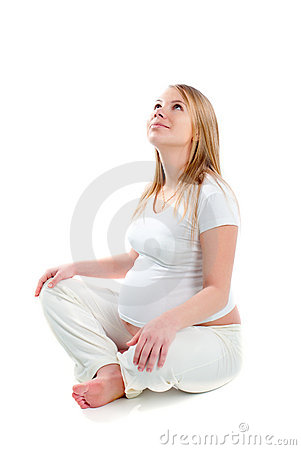 Pregnant woman in state of calm in studio