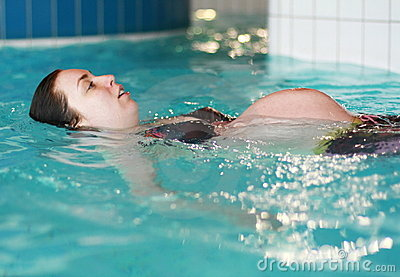 Pregnant woman swimming