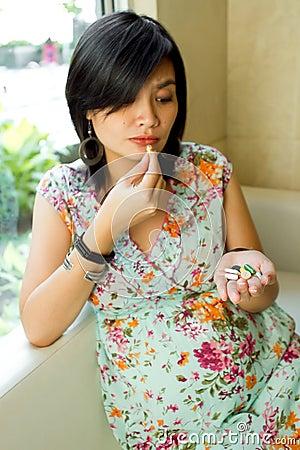 Pregnant Woman Take Various Pills