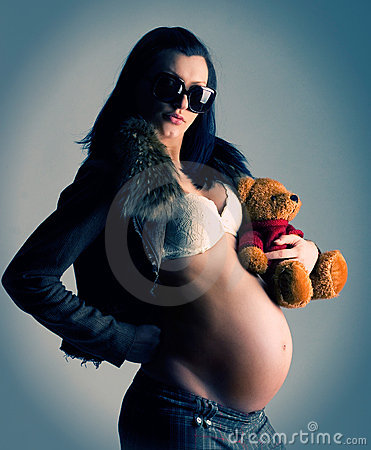 Pregnant woman with toy