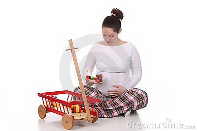 Pregnant woman and toys