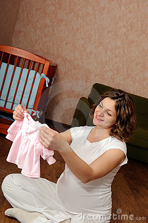 Free Pregnant Woman With Baby S Clothes Royalty Free Stock Photo - 16481625