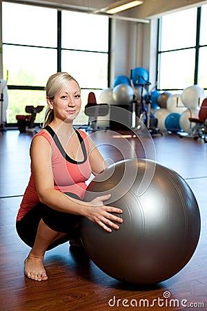 Pregnant women doing squatting exercise.