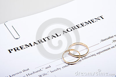 Prenuptial Agreement form and two wedding rings
