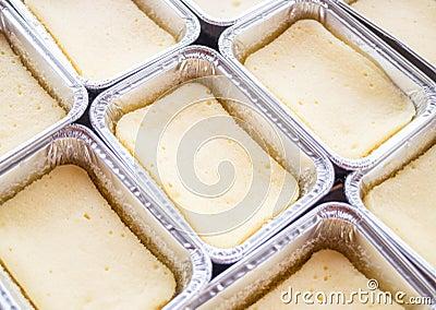Preparing cheese base square cake