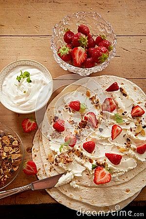 Free Preparing Fresh Strawberry And Cream Wraps Stock Images - 120965174