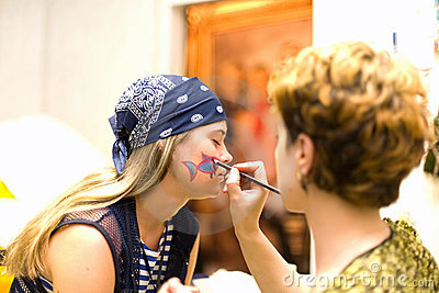 Preparing make up to actress before scene. Pencil