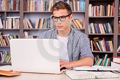 Preparing to exams in library.