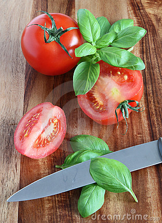 Preparing tomatoes and basil