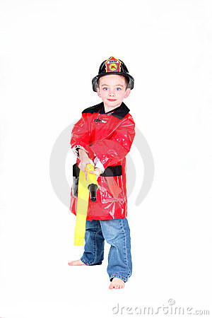 Preschool age boy in fireman costume